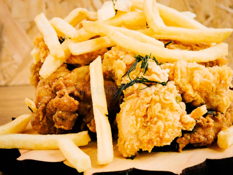 Breaded Crispy fried kentucky chicken tasty dinner.Close up Gourmet Main Dish for Dinner with Crispy Fried Chicken. Plate of fried chicken with french fries on royalty free stock images