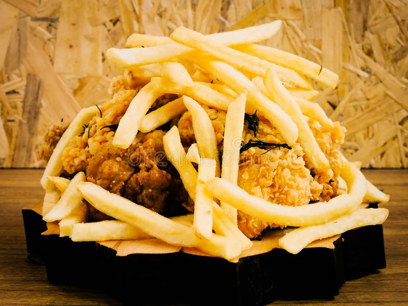 Breaded Crispy fried kentucky chicken tasty dinner.Close up Gourmet Main Dish for Dinner with Crispy Fried Chicken. Plate of fried chicken with french fries on royalty free stock photography