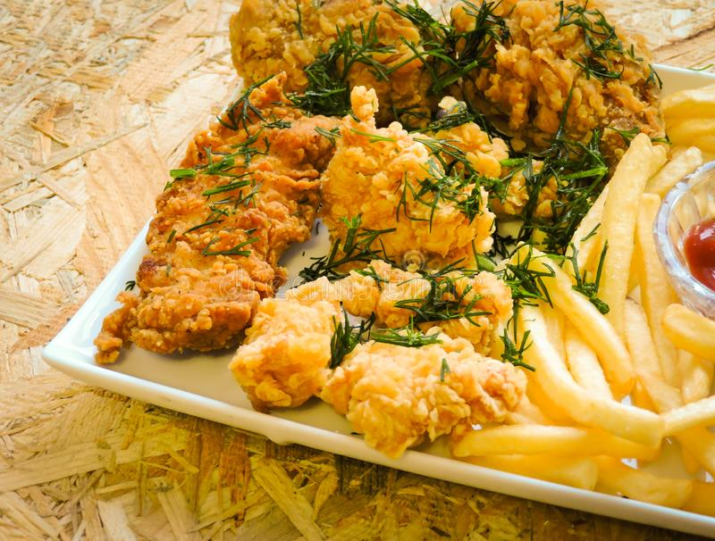 Breaded Crispy fried kentucky chicken tasty dinner.Close up Gourmet Main Dish for Dinner with Crispy Fried Chicken. Plate of fried chicken with french fries on stock photo