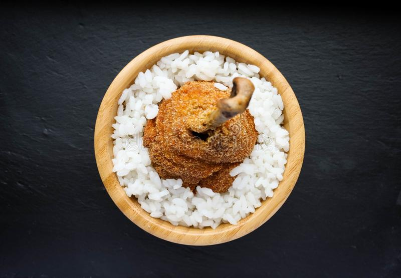 Breaded fried chicken leg with white rice stock photo