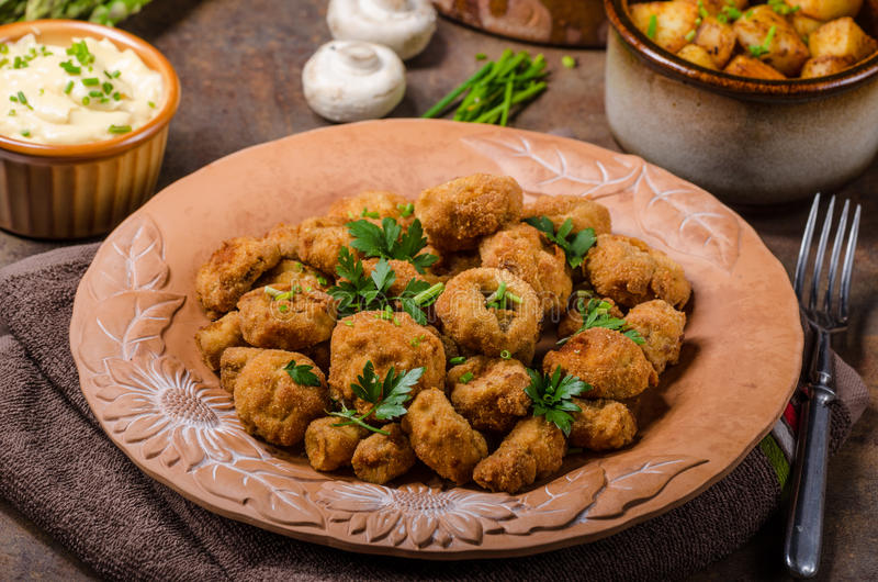 Breaded fried mushrooms. Delicious breaded fried mushrooms with homemade mayonnaise royalty free stock photography