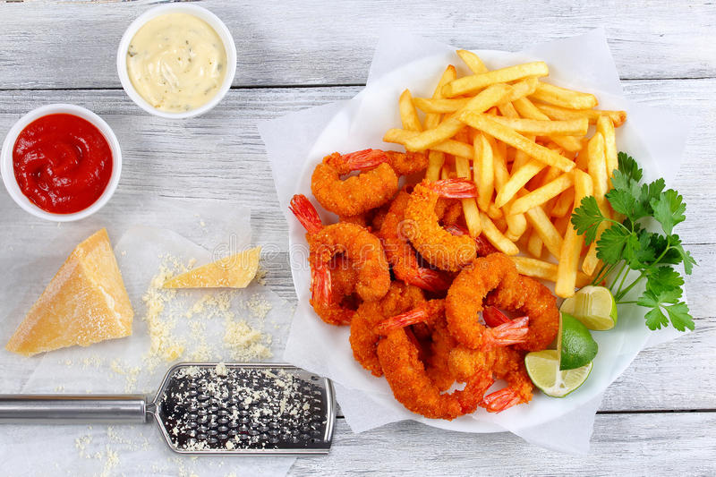 Breaded Fried Shrimps with french fries royalty free stock photo