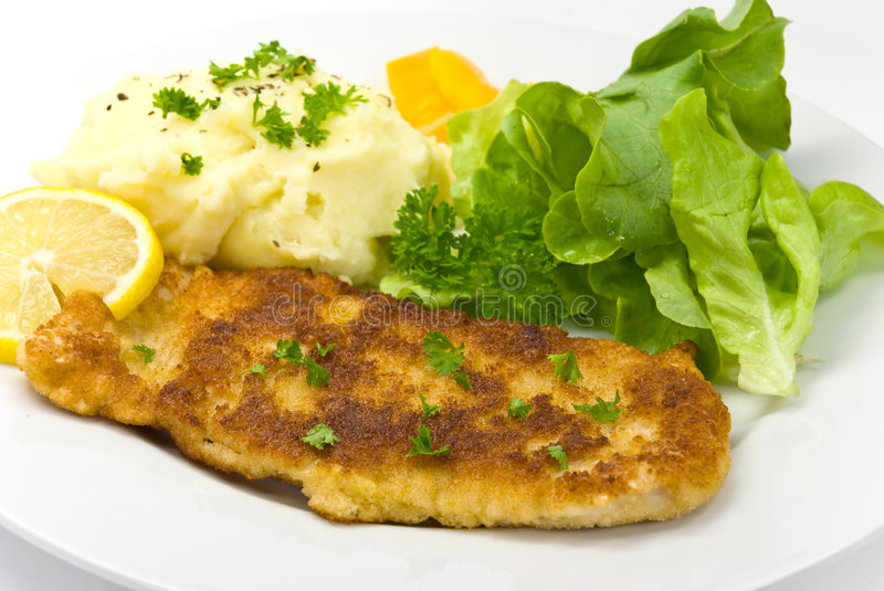 Breaded pork chop with lettuce stock photos