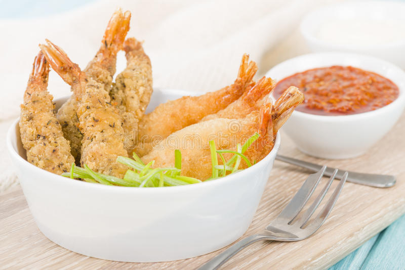 Breaded Prawns. King prawns coated in plain and spicy breadcrumbs and deep-fried royalty free stock photo