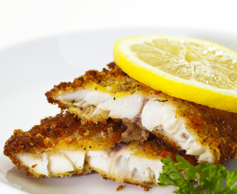 Breaded White Fish. Fried with lemon stock image