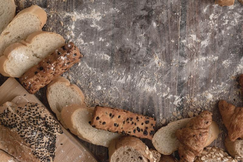 Breads and pastry flour on a wooden royalty free stock photos