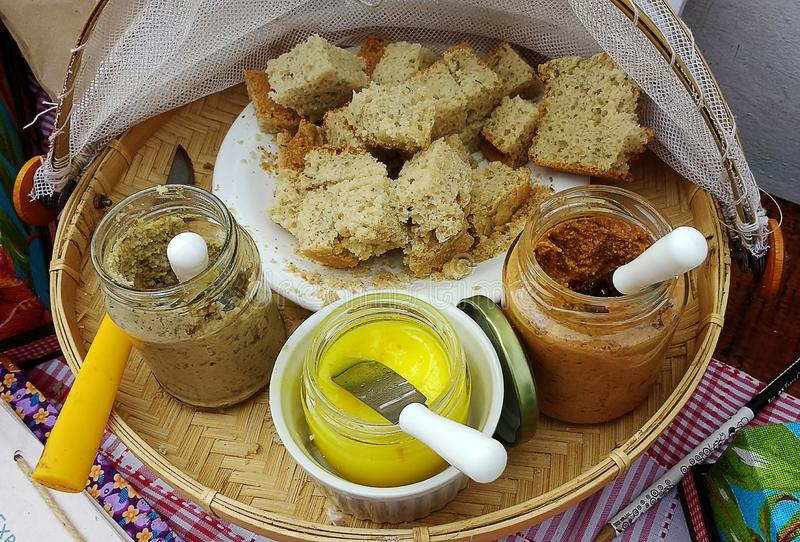 Breads and three vegan pastes royalty free stock image