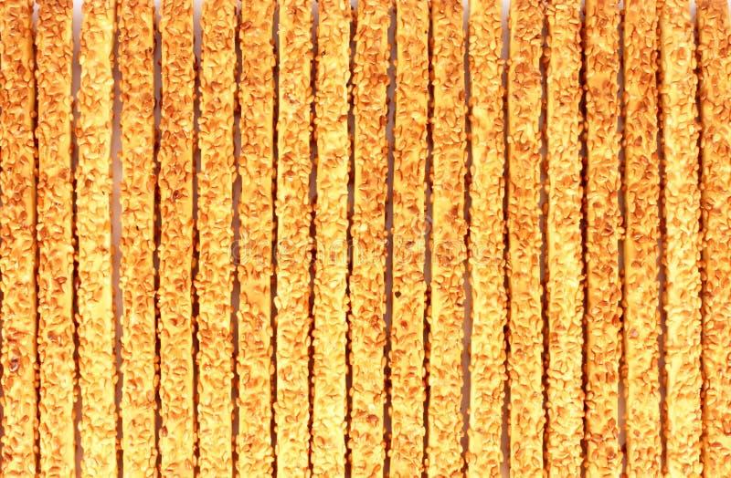 Breadsticks met sesamzadenachtergrond royalty-vrije stock fotografie