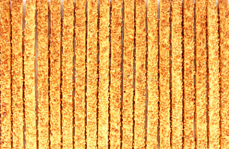 Breadsticks with sesame seeds background royalty free stock photography