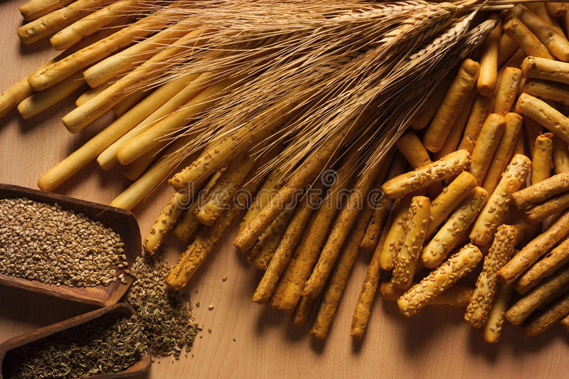 Breadsticks wheat and spices stock photos