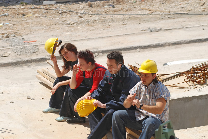 Break. Construction workers taking a break royalty free stock image