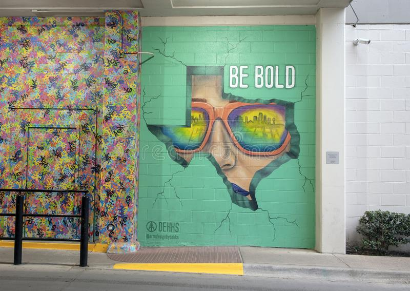 `Break Through & Be Bold`, a mural by Michelle Dekkers in the West Village, Dallas, Texas. Pictured is a mural by Michelle Dekkers titled  `Break Through & Be stock images