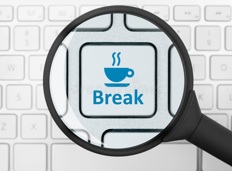 Break button under the magnifying glass. Computer key with break button under the magnifying glass stock photo