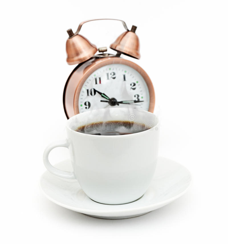 Wood Table Top On Blurred Beach Background Vintage Tone: Vintage Alarm Clock And White Coffee Cup Stock Photo