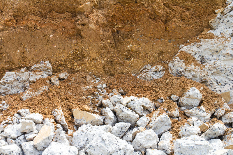 Break concrete layer of soil. Close up of a concrete bridge collapsed under a layer of soil, which dismantled New royalty free stock image