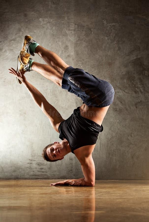 Break dance. Young strong man break dance royalty free stock images