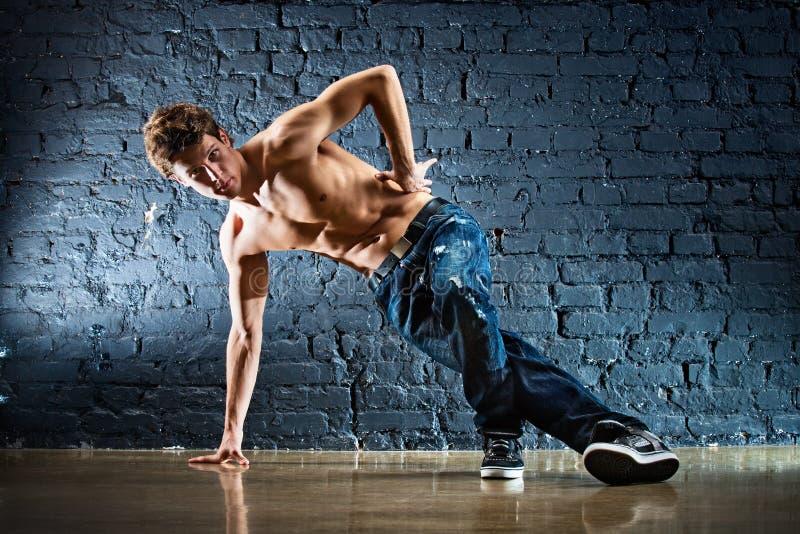 Break dance. Young strong man break dance stock image
