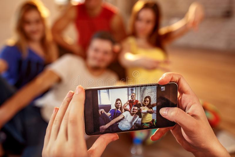Break dance, freestyle, hip-hop and street dance concept- picture of smiling dancer friends on smartphone stock photos