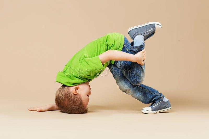 Break dance kids. little break dancer showing his skills. Break dance kids. little break dancer showing his skills in dance studio. Hip hop dancer boy royalty free stock image