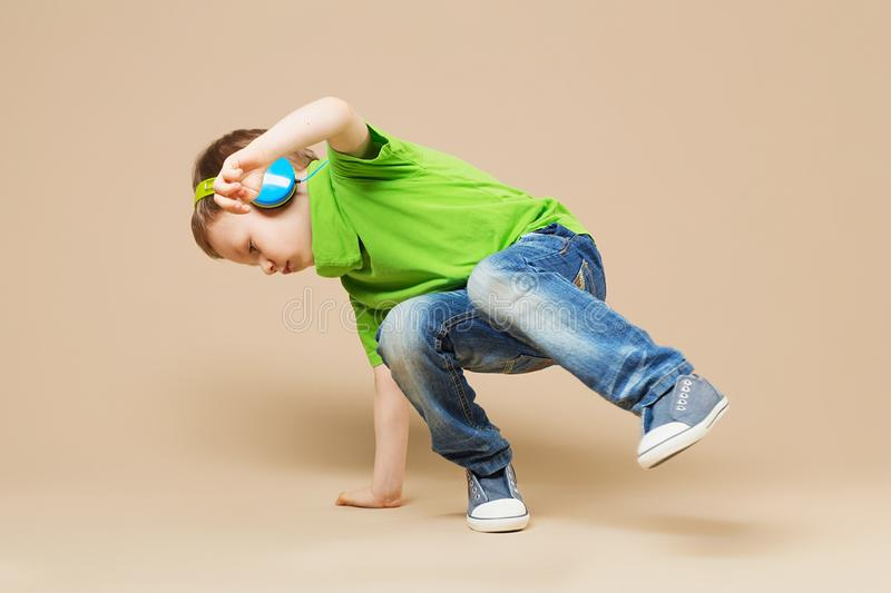 break dance kids. little break dancer showing his skills in dance studio. Hip hop dancer boy performing over studio background stock photos