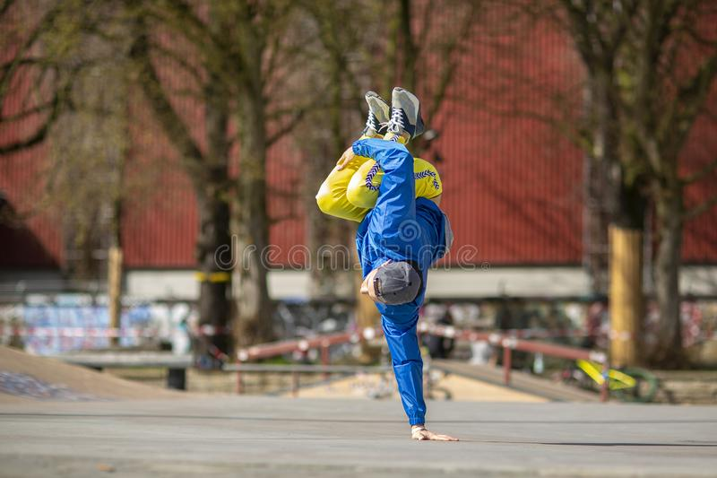 Break dance movement, performer on the street, Playground. Sports life royalty free stock photography