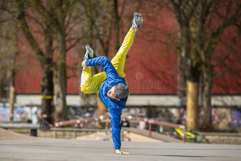 Break dance movement, performer on the street Playground. Break dance movement, performer on the street, Playground. Sports life stock photos
