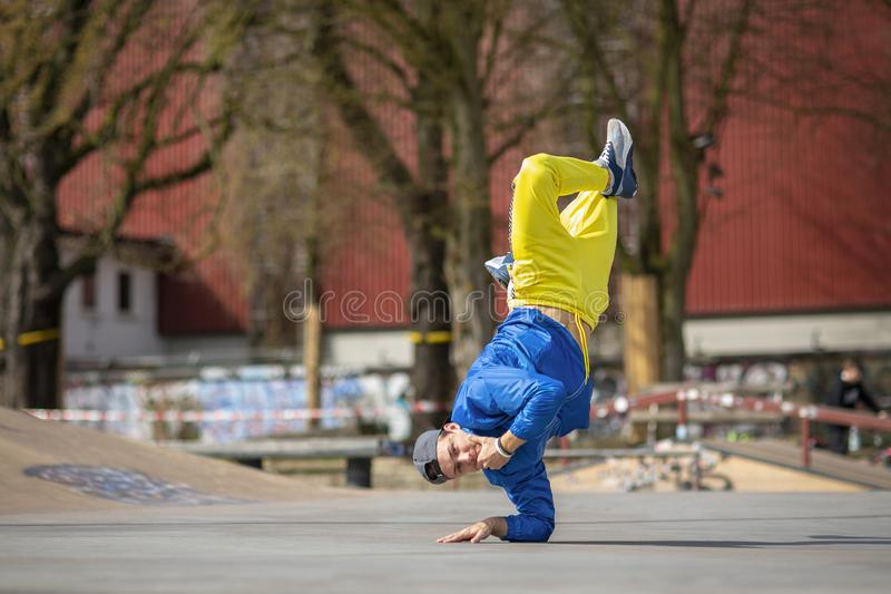 Break dance movement, performer on the street, Playground. Sports life stock photography