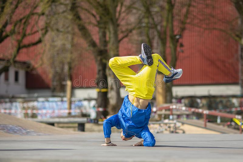Break dance movement, performer on the street Playground. Break dance movement, performer on the street, Playground. Sports life royalty free stock photography