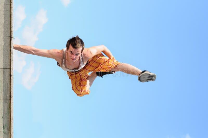Break-dance in sky. Man dances a break-dance against the sky royalty free stock images