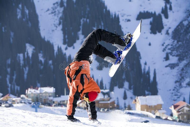 Break dance. Snowboarder, stunt. Tien Shan. Break dance. Snowboarder. Tien Shan stock photography