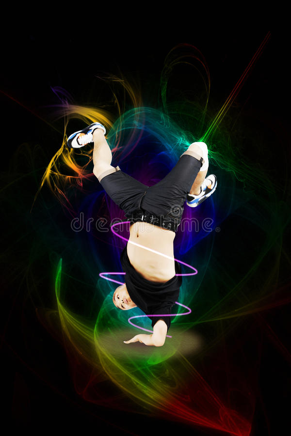 Break dancer on one arm over abstract background royalty free stock photos