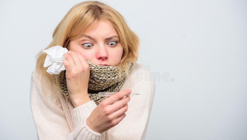 Break fever remedies. Seasonal flu concept. Woman feels badly. How to bring fever down. Fever symptoms and causes. Sick. Girl with fever. Girl sick hold royalty free stock image