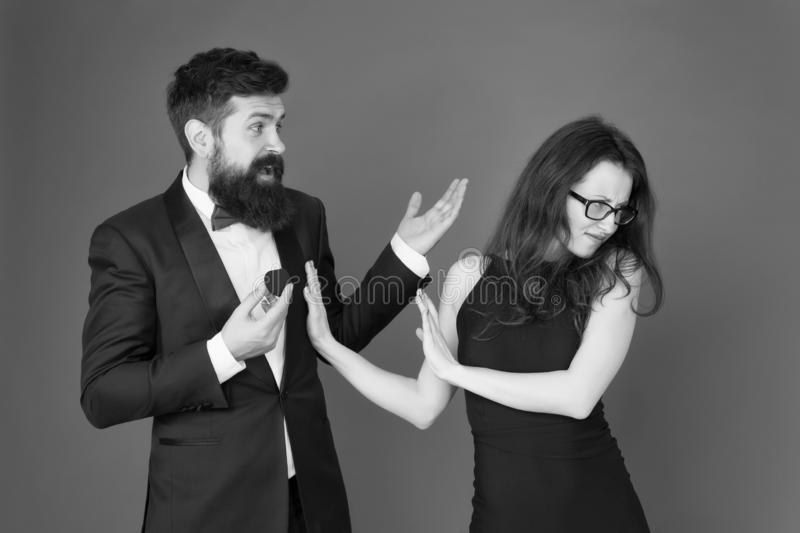 Break off wedding engagement. Bearded man give wedding ring to sensual woman. Couple in love in formal wear. Celebrate stock photo