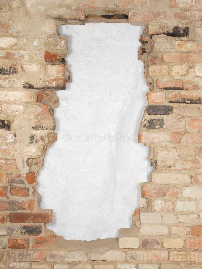Break the old brick wall consisting of a variety of bricks. royalty free stock photos