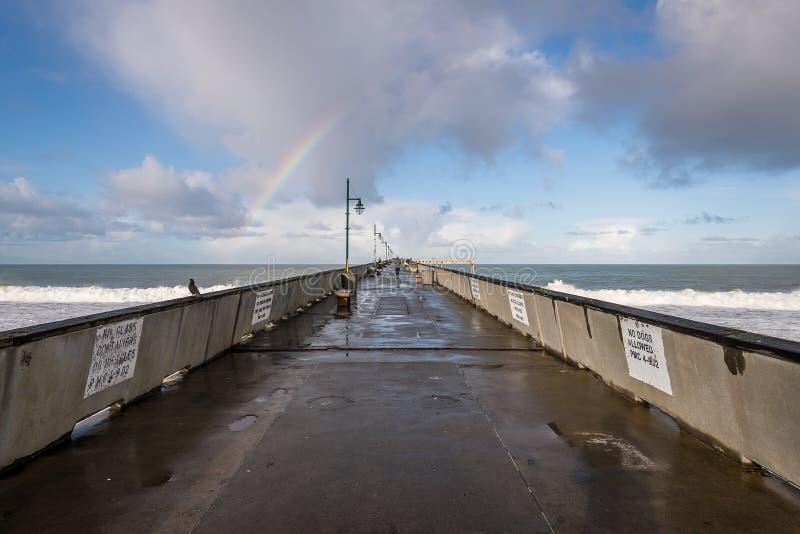 A rainbow over the Pacific Ocean royalty free stock photos