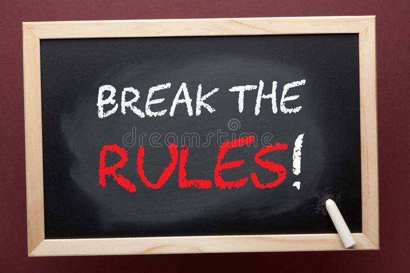 Break The Rules Concept. Break the rules written on blackboard by white chalk. Business concept stock images