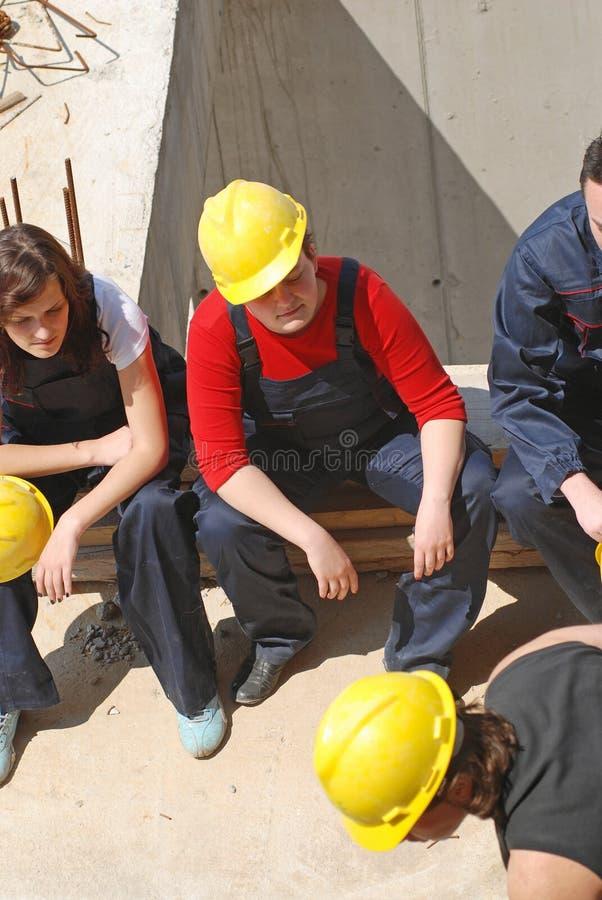 Break talk. Construction workers taking a break stock images