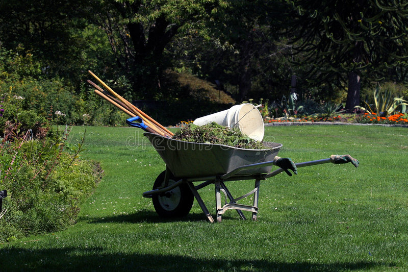 Break time. Gardener leaves his equipment while he takes a break from his landscaping duties stock photo