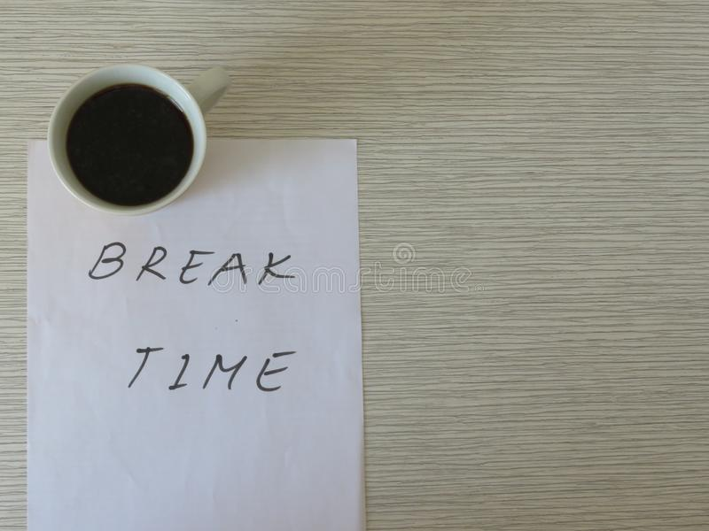 Break Time Concept. Relaxation. Office desk table with break time note and coffee cup. Top view. royalty free stock images
