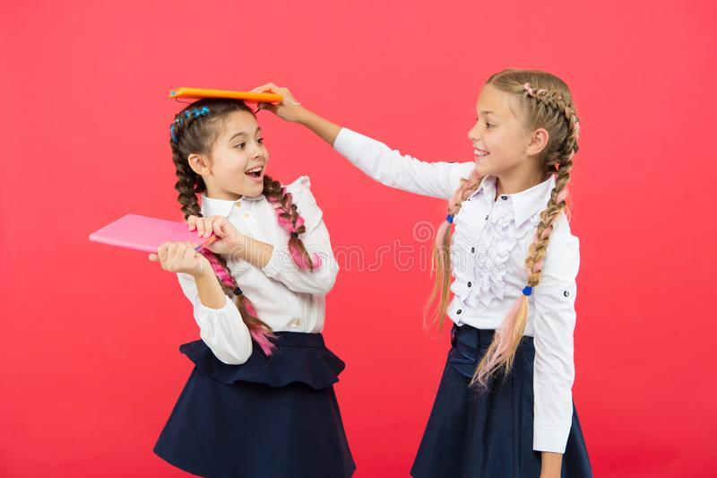 Break is time for fun. Education concept. Cute small children holding books. Adorable little girls with school exercise stock image