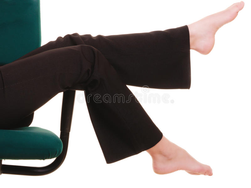 Break from work. Bare feet of businesswoman royalty free stock photography