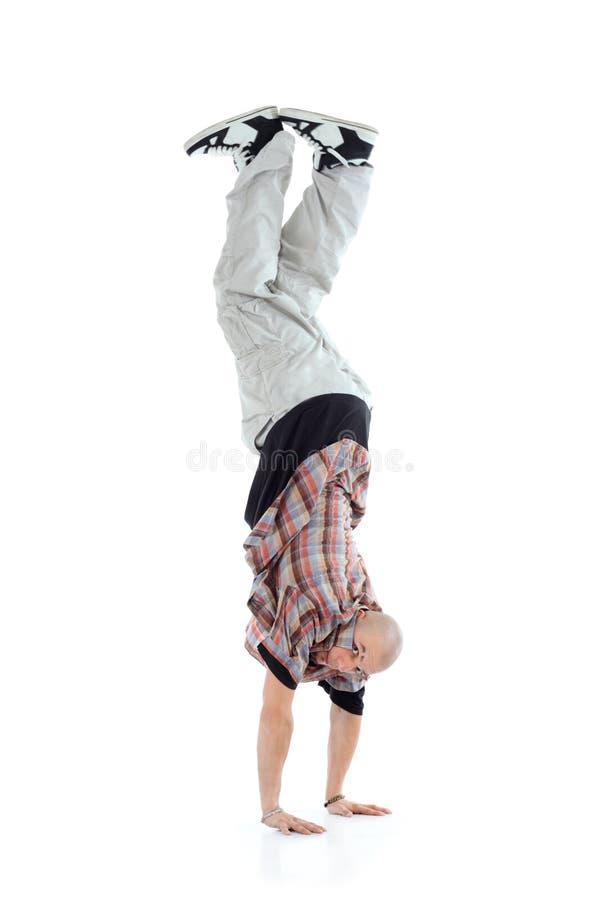 Breakdancer se coloca en dos manos foto de archivo libre de regalías