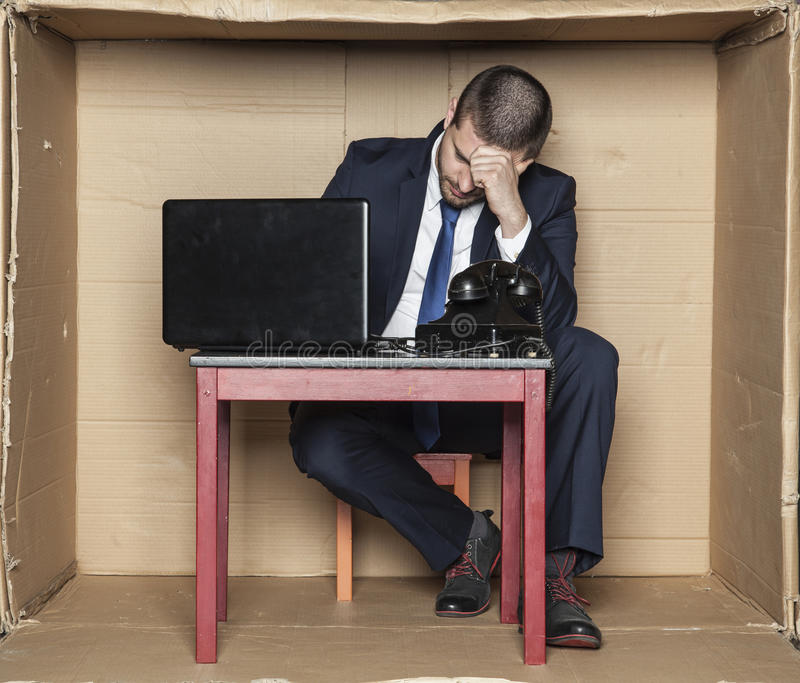 Breakdown at work, office situation. Business man royalty free stock photo
