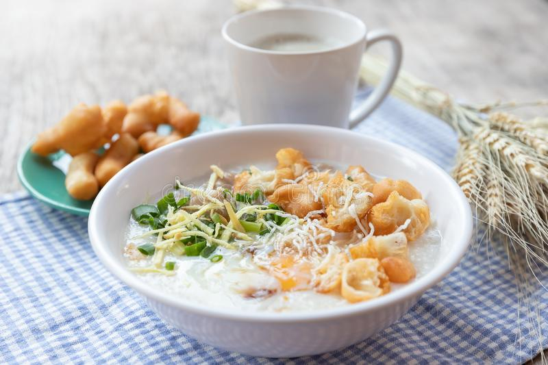 Breakfase meal. Congee or Rice porridge minced pork, boiled egg with soy milk and Chinese deep fried double dough stick.  royalty free stock images