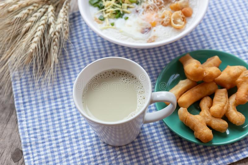 Breakfase meal. Congee or Rice porridge minced pork, boiled egg with soy milk and Chinese deep fried double dough stick.  stock photography