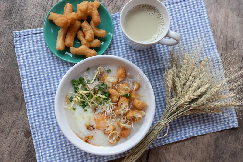 Breakfase meal. Congee or Rice porridge minced pork, boiled egg with soy milk and Chinese deep fried double dough stick.  stock images