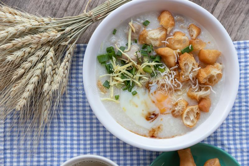 Breakfase meal. Congee or Rice porridge minced pork, boiled egg with soy milk and Chinese deep fried double dough stick.  royalty free stock image