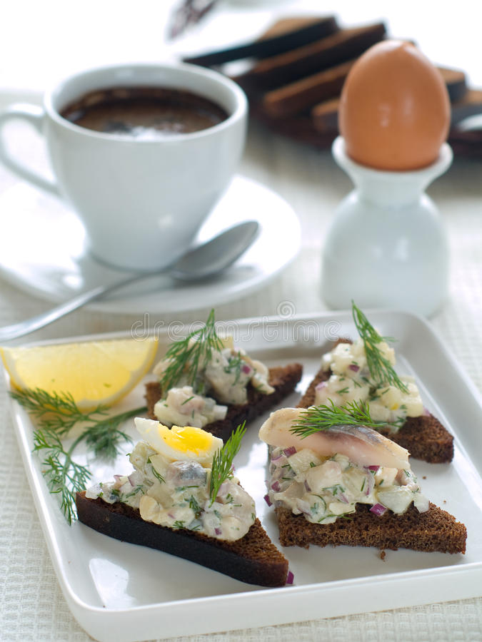 Breakfast. Sandwiches, egg and coffee for breakfast royalty free stock images