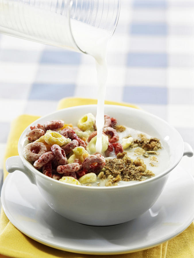 Breakfast. Stock image of the milk pouring to cereal stock photography