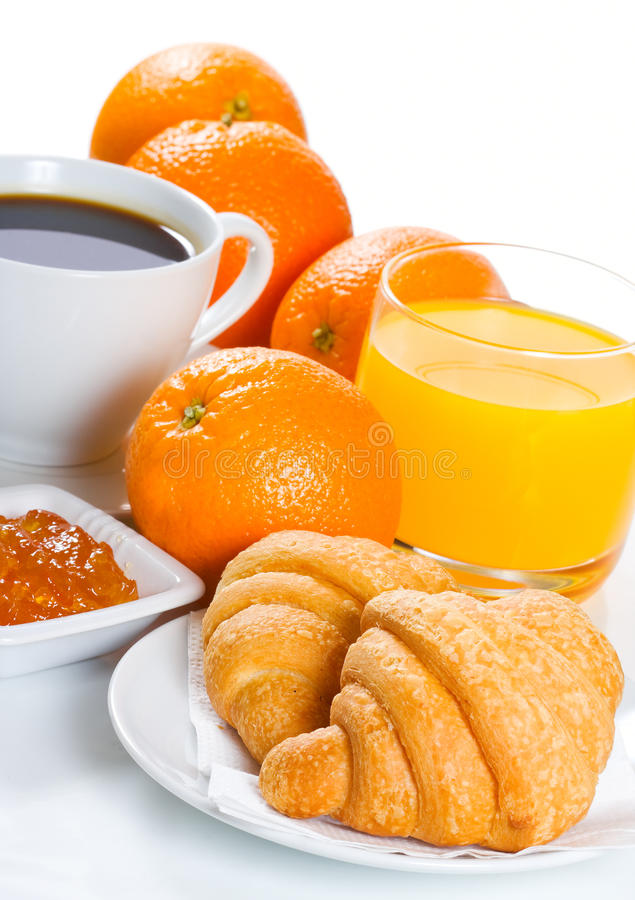 Breakfast. With croissant, coffee, juice and fruits royalty free stock photography